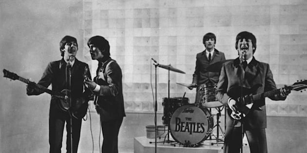 The Beatles are seen performing, date unknown.  From left to right:  Paul McCartney, George Harrison, Ringo Starr, and John Lennon.  (AP Photo)
