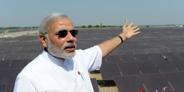 Chief Minister of the western Indian state of Gujarat Narendra Modi gestures as he poses at the inauguration of a solar farm in the village of Gunthawada, Banaskantha district, some 175kms. from Ahmedabad on October 14, 2011. Modi inaugrated the 30MW solar farm - said to be Asia's largest - which has been set up by Moser Baer Clean Energy. AFP PHOTO/Sam PANTHAKY (Photo credit should read SAM PANTHAKY/AFP/Getty Images)