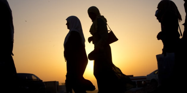 Palestinians walk towards cross the checkpoint on their way to attend the third Friday prayers in Jerusalem's al-Aqsa mosque during Muslim holy month of Ramadan, at the Qalandia checkpoint between the West Bank city of Ramallah and Jerusalem, Friday, June 24, 2016. (AP Photo/Majdi Mohammed)