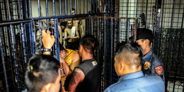 MANILA, PHILIPPINES - JUNE 20:  Drug suspects are led into a crowded jail cell on June 20, 2016 in Manila, Philippines. The president-elect of the Philippines, Rodrigo Duterte, declared a war on crime and drugs after sweeping an election on May 9 and has been living up to his nickname, 'the punisher'. Philippine police have been conducting night raids almost on a daily basis and revived a curfew for minors that had not been enforced for years, rounding up minors drinking on the streets. Based on local reports, there has been at least 59 drug-related deaths since the election and hundreds of drug suspects arrested over one month as Duterte reassured police on his full support if they killed criminals who resisted with violence. The raids have caused concern for Catholic church officials and human rights advocates as Duterte officially takes his oath as the 16th president of the Republic of the Philippines on June 30.  (Photo by Dondi Tawatao/Getty Images)