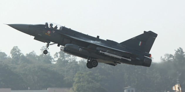 A HAL Tejas multirole light combat aircraft takes off for the type's initial operational clearance for induction into the Indian Air Force, in Bangalore on December 20, 2013. The Indian-built LCA (Light Combat Aircraft)Tejas received its Initial Operational Clearance (IOC II) on December 20, bringing it closer to the aircraft's induction into IAF service, a report said. AFP PHOTO/STR        (Photo credit should read STRDEL/AFP/Getty Images)