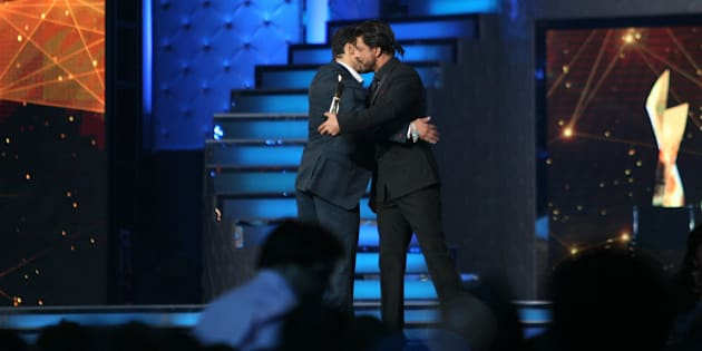 MUMBAI, INDIA -JANUARY 16: Bollywood actor Salman Khan hugs the 'Best Entertainer of the year Award Winner', Shah Rukh Khan at Star Guild Awards in Mumbai.(Photo by Milind Shelte/India Today Group/Getty Images)