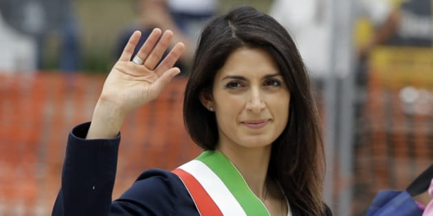 Rome's Mayor Virginia Raggi waves to reporters as she leaves the Rome's Vittoriano Unknown soldier monument, after laying a wreath, Thursday, June 23, 2016. The 5-Star Movement candidate in Rome, Virginia Raggi, a lawyer with a three-year stint as a city councilwoman, took 67.2 percent of the vote in a two-person runoff Sunday, becoming the corruption-stained capital city's first female mayor and, at 37, also its youngest. (AP Photo/Gregorio Borgia)