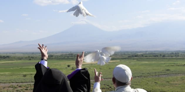 Pope Francis, right, and Catholicos Karekin II release white doves in front of Ararat's mountain after a ceremony at the Khor Virap's monastery, Armenia, Sunday, June 26, 2016. (L'Osservatore Romano/Pool photo via AP)