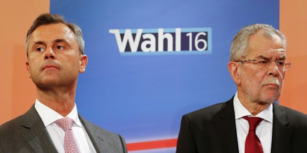 Presidential candidates Alexander Van der Bellen (R) and Norbert Hofer react during a TV debate in Vienna, Austria, April 24, 2016. REUTERS/Heinz-Peter Bader/File Photo TPX IMAGES OF THE DAY
