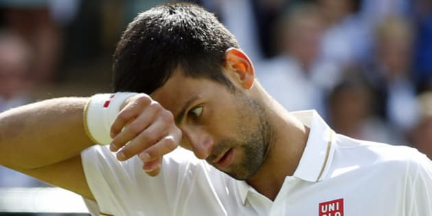 Novak Djokovic of Serbia wipes his face during his men's singles match against Sam Querrey of the U.S on day six of the Wimbledon Tennis Championships in London, Saturday, July 2, 2016. (AP Photo/Alastair Grant)