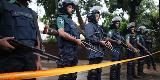 DHAKA, BANGLADESH - JULY 02 : Bangladeshi police stand guard outside the Holey Artisan Bakery cafe, currently under a hostage siege by armed gunmen in Dhaka, Bangladesh on July 02, 2016. Multiple foreigners are being held hostage by eight or nine gunmen at O'kitchen restaurant, in the same building as the the Holey Artisan Bakery cafe - a location popular with expatriates and diplomats. A gun battle between the attackers and police wounded three people, including two officers. Police and security forces have sealed off the area in the city's Gulshan district and are trying to negotiate a hostage release. (Photo by zakir hossain chowdhury/Anadolu Agency/Getty Images)