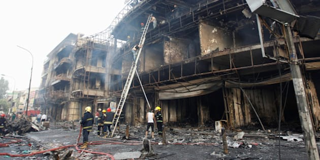 Firemen inspect the site of a suicide car bomb in the Karrada shopping area, in Baghdad, Iraq July 3, 2016. REUTERS/Khalid al Mousily