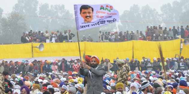 BATHINDA, INDIA - JANUARY 14: Aam Aadmi Party supporters during a public rally of Delhi Chief Minister Arvind Kejriwal on the occasion of Maghi Mela (festival) at Muktsar on January 14, 2016 in Bathinda, India. Giving a kick-start to AAP's campaign for 2017 Punjab polls, its convener Arvind Kejriwal launched a scathing attack on both Akalis and Congress, accusing them of being hand in glove with each other, and asked people to vote for AAP to end corruption, drug abuse, farmer suicides and put the state back on right track. (Photo by Sameer Sehgal/Hindustan Times via Getty Images)