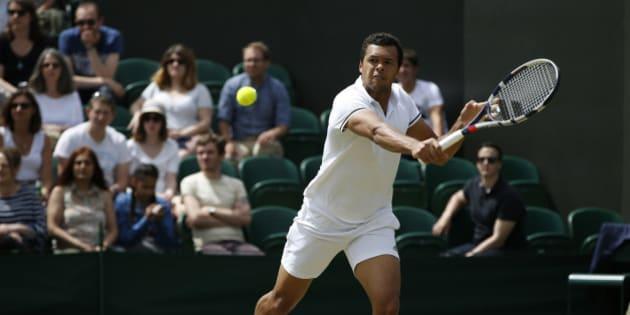 Britain Tennis - Wimbledon - All England Lawn Tennis & Croquet Club, Wimbledon, England - 3/7/16 France's Jo-Wilfried Tsonga in action against USA's John Isner REUTERS/Paul Childs