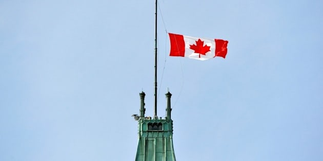 OTTOWA, CANADA - JUNE 30: Canadian national flag flies at half mast over the Peace Tower in Ottowa, Canada on June 30, 2016 following the recent terrorist attack at Istanbul Ataturk International Airport. (Photo by Seyit Aydogan/Anadolu Agency/Getty Images)