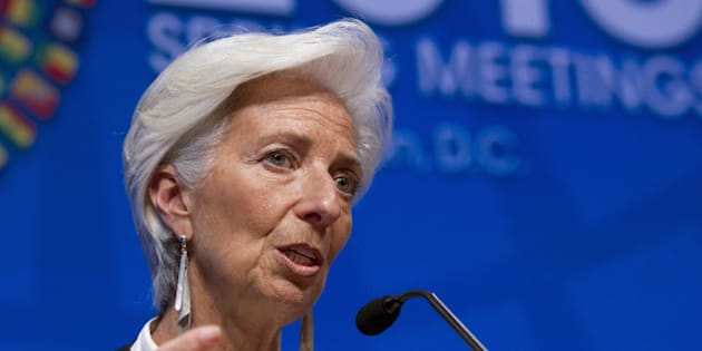 """FILE - In this Saturday, April 16, 2016, file photo, International Monetary Fund Managing Director Christine Lagarde speaks during a news conference after the International Monetary and Financial Committee conference at the World Bank/IMF Spring Meetings at IMF headquarters in Washington. The IMF said Wednesday, June 22, 2016, it is downgrading its forecast for the U.S. economy this year and says America should raise the minimum wage to help the poor and offer paid maternity leave to encourage more women to work. Lagarde, noting low unemployment and strong hiring over the past year, says """"the U.S. economy is in good shape.'' (AP Photo/Jose Luis Magana, File)"""