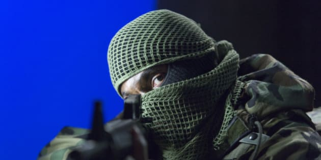 A soldier pointing a gun.