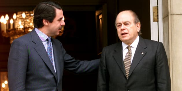 Spanish Prime Minister Jose Maria Aznar (L) talks to Catalan President Jordi Pujol before their meeting at Moncloa Palace February 16. Aznar discussed domestic and European issues with his parliamentary ally.  SP/WS