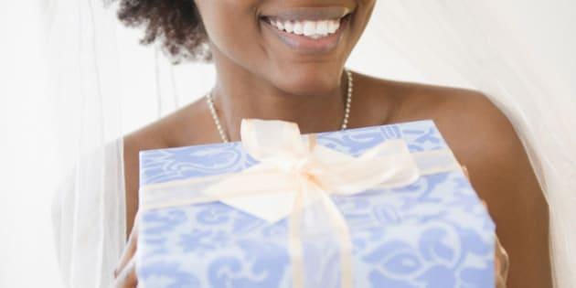 black bride holding wedding gift