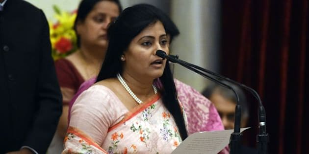 Bharatiya Janata Party (BJP) politician, Anupriya Singh Patel takes the oath during the swearing-in ceremony of new ministers following Prime Minister Narendra Modi's cabinet re-shuffle, at the Presidential Palace in New Delhi on July 5, 2016. Indian Prime Minister Narendra Modi revamped his cabinet on July 5 bringing in 19 new junior ministers to speed up decision-making and delivery on promises made in this year's budget. / AFP / Prakash SINGH        (Photo credit should read PRAKASH SINGH/AFP/Getty Images)