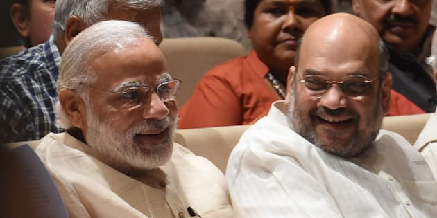 India Bharatiya Janata Party (BJP) President Amit Shah (R) speaks with Prime Minister Narendra Modi during a BJP Parliamentary committee meeting in New Delhi on May 3, 2016,  / AFP / Prakash SINGH        (Photo credit should read PRAKASH SINGH/AFP/Getty Images)