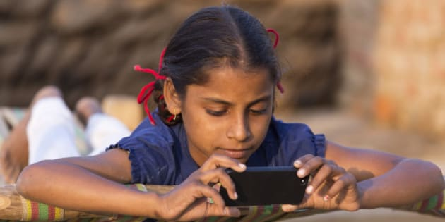 India, Uttar Pradesh, Agra, young girl loooking at smartphone.