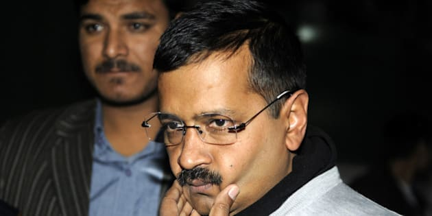 NEW DELHI, INDIA - DECEMBER 15: Delhi Chief Minister Arvind Kejriwal talking with media person outside the residence of Deputy Chief Minister Manish Sisodia on CBI raid on office of his Principal Secretary on December 15, 2015 in New Delhi, India. Enraged over this issue, Kejriwal claimed that his office was raided by CBI team allegedly on the orders of Prime Minister Narendra Modi. The central government rejected saying that it has no role to play in the raid. CBI investigators searched the office of Rajendra Kumar, Principal Secretary to the Delhi government, situated near Kejriwal's office in connection with corruption case. (Photo by Sonu Mehta/Hindustan Times via Getty Images)