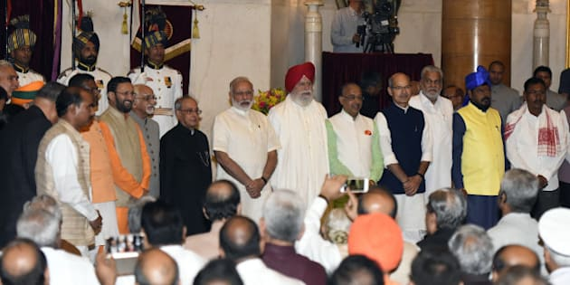NEW DELHI, INDIA - JULY 5:  President Pranab Mukherjee, Prime Minister Narendra Modi and Vice President Hamid Ansari all the newly inducted ministers  during the swearing-in ceremony of new ministers following Prime Minister Narendra Modi's cabinet re-shuffle, at the Rashtrpati Bhawan on July 5, 2016 in New Delhi, India. Indian Prime Minister Narendra Modi revamped his cabinet bringing in 19 new junior ministers to speed up decision-making and delivery on promises made in this year's budget. (Photo by Sonu Mehta/Hindustan Times via Getty Images)