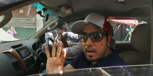 NEW DELHI, INDIA - JUNE 11: Singer Mika Singh who is accused of slapping a doctor at a concert being taken to Inderpuri Police station after his arrest on June 11, 2015 in New Delhi, India. The incident happened in April when footage of the singer assaulting the doctor in full public view, went viral. The singer was later released on bail. (Photo by Sanjeev Verma/Hindustan Times via Getty Images)