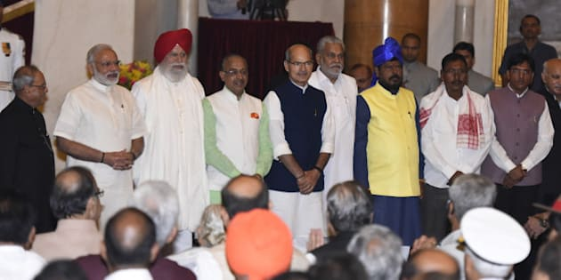 NEW DELHI, INDIA - JULY 5:  President Pranab Mukherjee and Prime Minister Narendra Modi with all the newly inducted ministers  during the swearing-in ceremony of new ministers following Prime Minister Narendra Modi's cabinet re-shuffle, at the Rashtrpati Bhawan on July 5, 2016 in New Delhi, India. Indian Prime Minister Narendra Modi revamped his cabinet bringing in 19 new junior ministers to speed up decision-making and delivery on promises made in this year's budget. (Photo by Sonu Mehta/Hindustan Times via Getty Images)