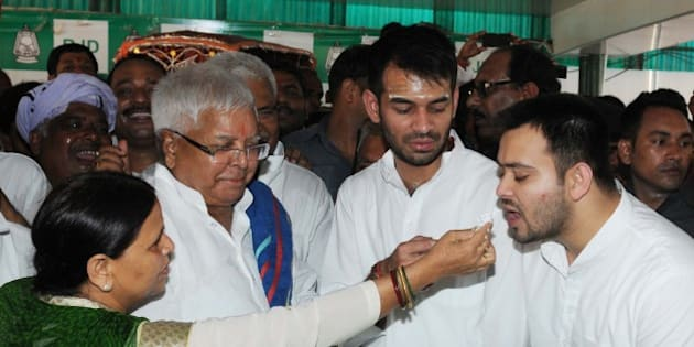 PATNA, INDIA - JUNE 11: RJD Chief Lalu Prasad Yadav Lalu Yadav celebrated his 69th birthday with his wife, Rabri Devi and two sons Tejaswi Yadav and Tej Pratap Yadav, on June 11, 2016 in Patna, India. The veteran politician of Bihar was greeted by a number of state leaders cutting across political lines. (Photo by AP Dube/Hindustan Times via Getty Images)