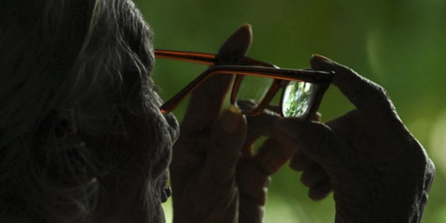 Grace, 90, looks through her glasses after a cataract surgery in Hyderabad, India, Wednesday, Oct. 8, 2008, on the eve of World Sight Day. (AP Photo/Mahesh Kumar A.)