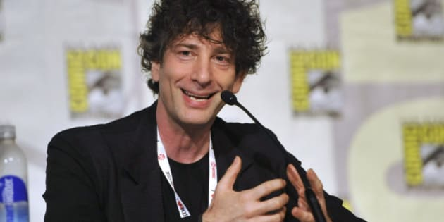 """FILE - This July 21, 2013 file photo shows Neil Gaiman speaking at the Spotlight on Neil Gaiman panel on Day 5 of Comic-Con International in San Diego. Gaiman says his return to Vertigo Comics' realm of the Endless is no mere continuation of the series that spawned a creative revolution altering the medium. Instead, """"The Sandman: Overture"""" is a chance to do the """"weird things"""" and """"different things"""" that he never got to explore in writing the best-selling and critically lauded series. (Photo by Chris Pizzello/Invision/AP, File)"""
