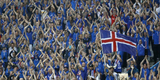 Iceland fans clap their hands prior to the Euro 2016 quarterfinal soccer match between France and Iceland, at the Stade de France in Saint-Denis, north of Paris, France, Sunday, July 3, 2016. (AP Photo/Frank Augstein)