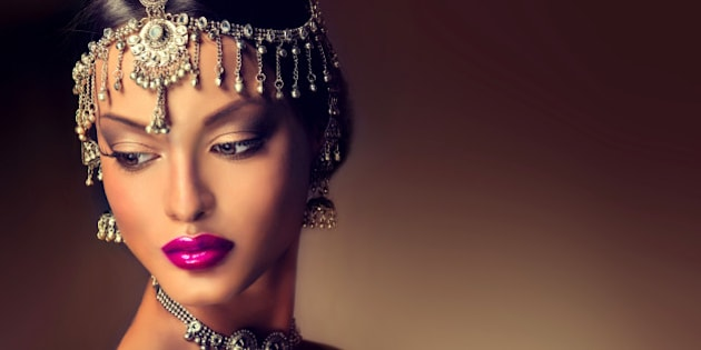Beautiful Indian women portrait with jewelry . elegant Indian girl looking to the side ,bollywood style.