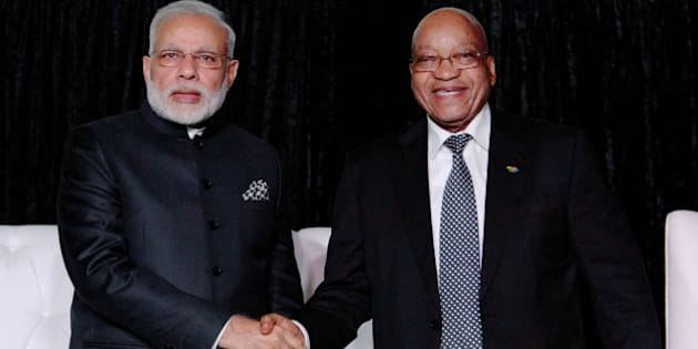 South African President Jacob Zuma (R) and Indian Prime Minister Narendra Modi shake hands as they attend the South Africa-India Business Forum at the CSIR International Convention Centre in Pretoria on July 8, 2016.