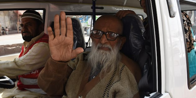In this photograph taken on February 15, 2016, Abdul Sattar Edhi, the head of Edhi Foundation, waves as he journeys to his office in the port city of Karachi.  He created a charitable empire out of nothing, masterminding Pakistan's largest welfare organisation. Today Abdul Sattar Edhi is revered by many as a national hero. / AFP / ASIF HASSAN / To go with ' Pakistan-Social-Health' FEATURE by Caroline Nelly Perrot        (Photo credit should read ASIF HASSAN/AFP/Getty Images)