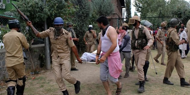 Indian police carry the body of a slain youth outside a hospital in Srinagar on July 9, 2016. Clashes spread across the disputed territory as protesters angry at the killing on Friday of Hizbul Mujahideen (HM) leader Burhan Wani torched police stations and threw rocks at army camps in the south of the restive region.Four have died of bullet wounds and 60 injured have been brought in so far, six of them are in a critical condition,' a staff member at a hospital in the southern town of Anantnag told AFP, asking to remain anonymous.  / AFP / -        (Photo credit should read -/AFP/Getty Images)