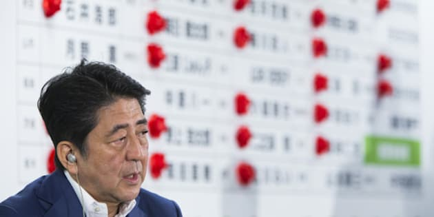 Shinzo Abe, Japan's prime minister and president of the Liberal Democratic Party (LDP), speaks to the media after the upper house election at the party's headquarters in Tokyo, Japan, on Sunday, July 10, 2016. Abe's conservative ruling coalition and its allies appear set to expand their majority in Sunday's upper house election, an NHK exit poll showed, and may win a two-thirds majority that will allow him to press ahead with plans to revise the pacifist constitution. Photographer: Tomohiro Ohsumi/Bloomberg via Getty Images