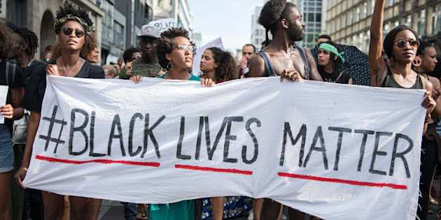 Protestors hold a banner reading 'Black Lives Matter' during a demonstration in Berlin, on July 10, 2016 with the motto 'Black Lives Matter - No Justice = No Peace' as protest over the deaths of two black men at the hands of police last week. / AFP / dpa / Wolfram Kastl / Germany OUT        (Photo credit should read WOLFRAM KASTL/AFP/Getty Images)
