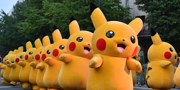 Costumed performers as Pikachu, the popular animation Pokemon series character, perform at the Yokohama Dance Parade in Yokohama on August 2, 2015. The dance began on August 1 and will run for 65 days throughout the city, with more than 200 dance programmes.    AFP PHOTO / KAZUHIRO NOGI        (Photo credit should read KAZUHIRO NOGI/AFP/Getty Images)