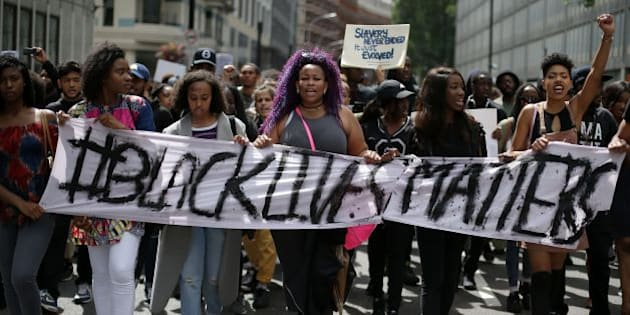 Demonstrators from the Black Lives Matter movement march through the streets of central London on July 10, 2016, during a demonstration against the killing of black men by police in the US.  Police arrested scores of people in demonstrations overnight Saturday to Sunday in several US cities, as racial tensions simmer over the killing of black men by police. / AFP / DANIEL LEAL-OLIVAS        (Photo credit should read DANIEL LEAL-OLIVAS/AFP/Getty Images)
