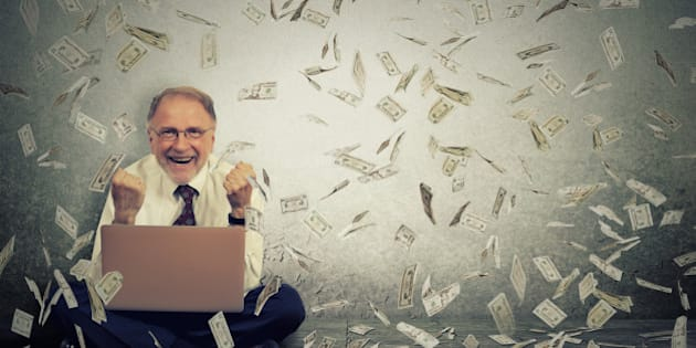 Senior business man using a laptop building online business making money dollar bills cash falling down. Money rain. IT entrepreneur online job success economy concept