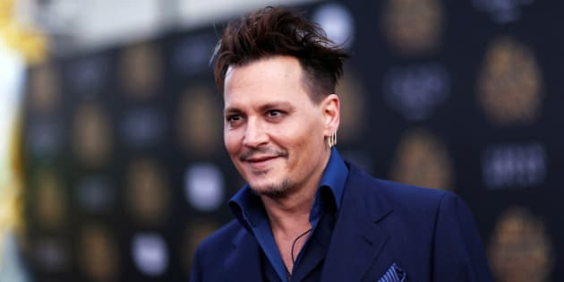 """Cast member Johnny Depp poses at the premiere of """"Alice Through the Looking Glass"""" at El Capitan theatre in Hollywood, U.S., May 23, 2016. REUTERS/Mario Anzuoni"""