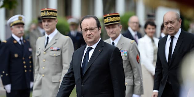 French President Francois Hollande (front C) walks ahead of French defence Minister Jean-Yves Le Drian (R) and French Army Chief of Staff General Pierre de Villiers (back R) as they arrive for a ceremony to present diplomas to graduates of voluntary military service in Bretigny-sur-Orge, near Paris, France, July 5, 2016.   REUTERS/Stephane de Sakutin/Pool
