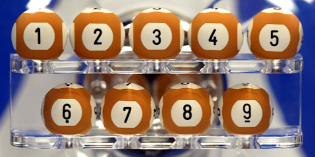 Balls are seen during a rehearsal of the draw of the new Euro-million loto at Boulogne-Billancourt near Paris, February 13, 2004. The Euro-million loto will be played simultaneously in England, Spain and France with a weekly French draw with a possible jackpot of over 30 million euros (35 million dollars). REUTERS/Charles Platiau  CP/ACM