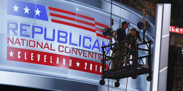 The main stage on the convention floor at the Quicken Loans Arena in downtown Cleveland, Ohio, is prepared for the upcoming Republican National Convention, as workers stand in a man lift on Wednesday, July 13, 2016. (AP Photo/Gene J. Puskar)