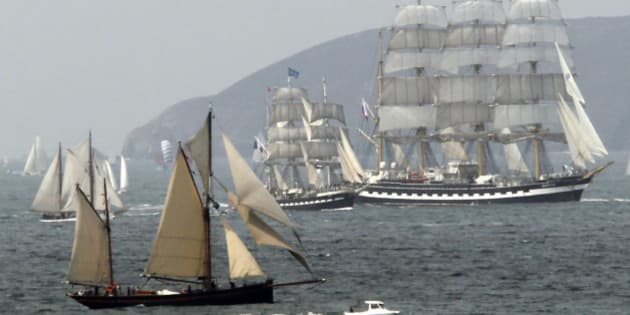 """The four-masted Russian tall ship Kruzenshtern (R) is flanked by the French tall ship Bellem (C) as they enter the Bay of Douarnenez as part of an armada participating in the """"Tonnerre de Brest"""" maritime festival in Finistere, Brittany, in western France, July 19, 2012.   REUTERS/Mal Langsdon (FRANCE - Tags: SOCIETY MARITIME TRAVEL SPORT YACHTING)"""