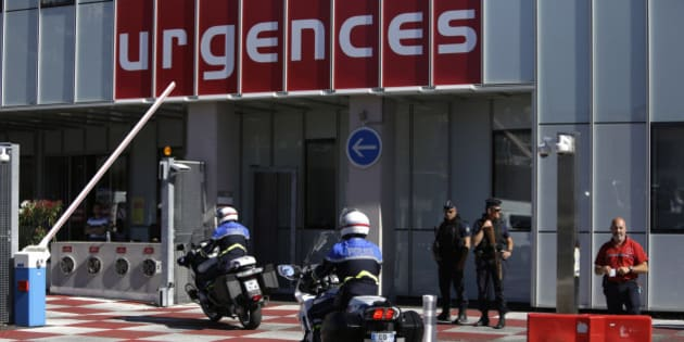 Riot olice officers and gendarmes are pictured outside the Pasteur Hospital in Nice, southern France, Friday July 15, 2016.  A large truck plowed through revelers gathered for Bastille Day fireworks in Nice, killing more than 80 people and sending others fleeing into the sea as it bore down for more than a mile along the Riviera city's famed waterfront promenade. (AP Photo/Claude Paris)