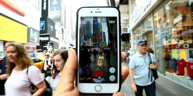 NEW YORK, NY - JULY 13: A Pokemon Go user plays Pokemon GO game in New York City, NY on July 13, 2016. Pokemon Go is a free-to-play location-based augmented reality mobile game which allows players to capture, battle, and train virtual Pokemon who appear throughout the real world. Pokemon Go was rolled out to iPhone and Android smartphone users in the United States, Australia and New Zealand on July 6.   (Photo by Volkan Furuncu/Anadolu Agency/Getty Images)