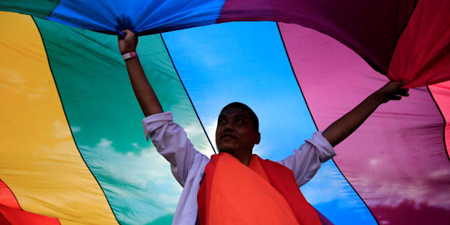 A man displays a rainbow flag during a LGBT Pride parade in metro Manila, Philippines June 25, 2016. REUTERS/Romeo Ranoco     TPX IMAGES OF THE DAY