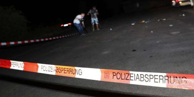 Cameramen film at the scene where a man was shot dead by the police after attacking passengers on a train with an axe near the city of Wuerzburg, Germany July 19, 2016.  REUTERS/Kai Pfaffenbach