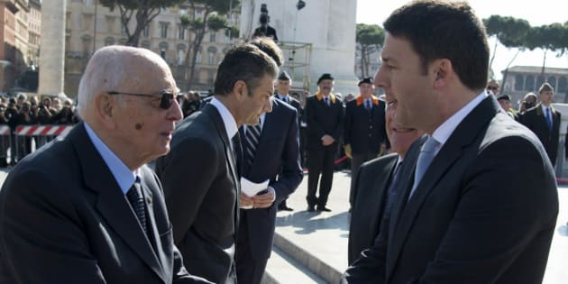 Italy's President Giorgio Napolitano (L) shakes hands with Prime Minister Matteo Renzi as he arrives to attend a Liberation Day ceremony at the Unknown Soldier's monument in central Rome April 25, 2014, in this handout provided by the Italian Presidency Press Office. REUTERS/Paolo Giandotti/Italian Presidency Press Office/Handout via Reuters (ITALY - Tags: POLITICS MILITARY ANNIVERSARY) ATTENTION EDITORS - THIS PICTURE WAS PROVIDED BY A THIRD PARTY. REUTERS IS UNABLE TO INDEPENDENTLY VERIFY THE AUTHENTICITY, CONTENT, LOCATION OR DATE OF THIS IMAGE. THIS PICTURE IS DISTRIBUTED EXACTLY AS RECEIVED BY REUTERS, AS A SERVICE TO CLIENTS. FOR EDITORIAL USE ONLY. NOT FOR SALE FOR MARKETING OR ADVERTISING CAMPAIGNS