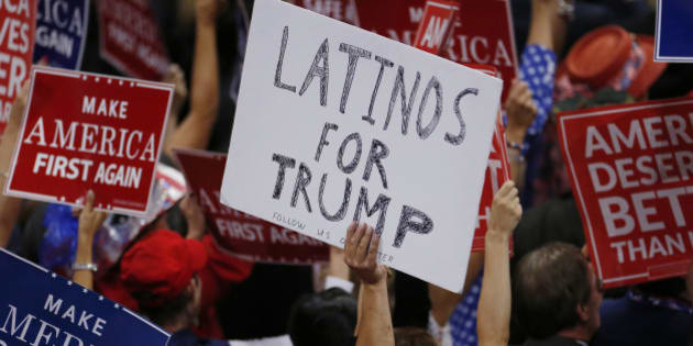 A person holds a sign reading 'Latinos for Trump' on the third day of the Republican National Convention in Cleveland, Ohio, U.S. July 20, 2016. REUTERS/Carlo Allegri